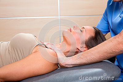 Myofascial therapy technique with therapist hands in woman