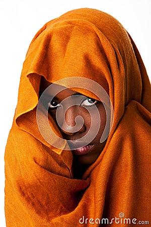 Mysterious female face in ocher head wrap