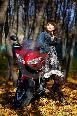 The mysterious girl about a red motorcycle