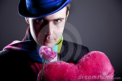 Mysterious men with toy and rose