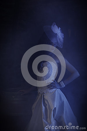 Free Mysterious Woman In Wedding Dress Surrounded By Blue Smoky Haze Stock Photography - 36258372