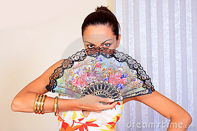 Mystery girl holding a fan