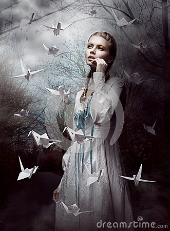 Night. Woman in  Mysterious Forest launching handmade paper Cranes. Origami