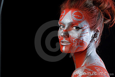 Mystic young woman with painted face