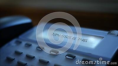Número genérico que llama el mensaje en sistema moderno de la línea horizonte del negocio almacen de metraje de vídeo
