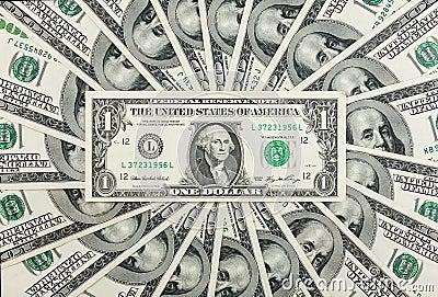 Één dollar ligt tegen de achtergrond van honderd-dollar rekeningen