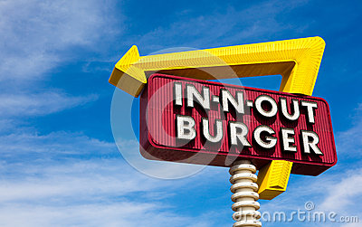 In-n-Out burger sign in front of blue sky Editorial Stock Image