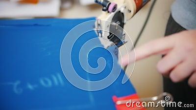 Naaister Cutting Fabric stock footage