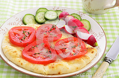 Naan bread with tomato slices