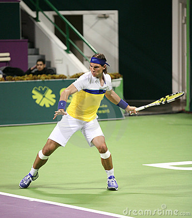 Nadal in action at the Qatar Open Editorial Photography