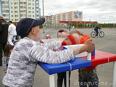 Nadym, Russia - June 28, 2008: Competitions on arm-wrestling. St Editorial Photo