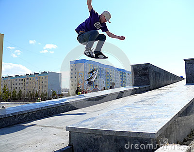 Nadym, Russia - May 17, 2008: Jumping on Board with a springboar Editorial Stock Photo