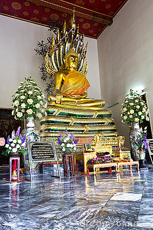 Naga Buddha on Snake Base in Wat pol Thailand