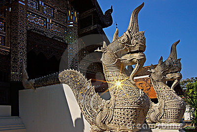 Naga statues protect the entrance to Thai temples