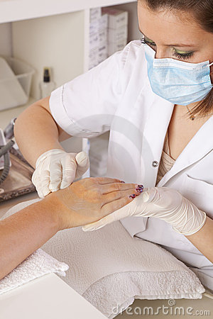 Nail designer giving skin care