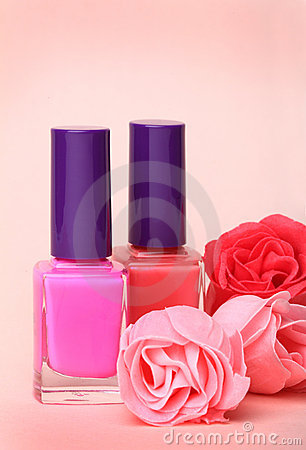 Nail polish bottles and rose flowers