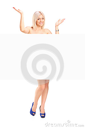 Naked blond woman behind white panel