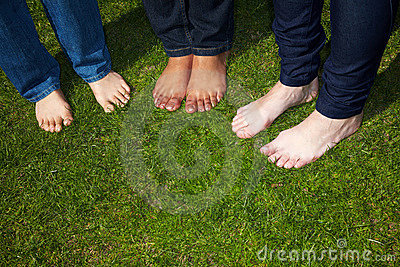 Naked feet in grass