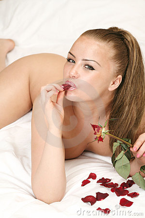 Naked Girl On Bed With Rose Royalty Free Stock