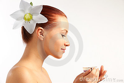 Naked girl with flower in hairs