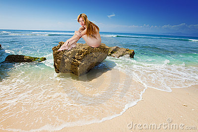 The naked girl on a stone