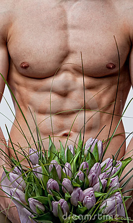 Naked man with bouquet of tulips