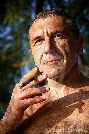 Naked man with a cigar