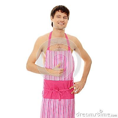 Naked man wering pink apron