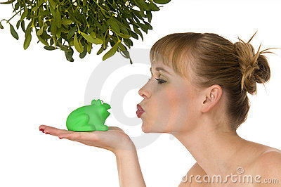 Naked woman kissing a frog under mistletoe