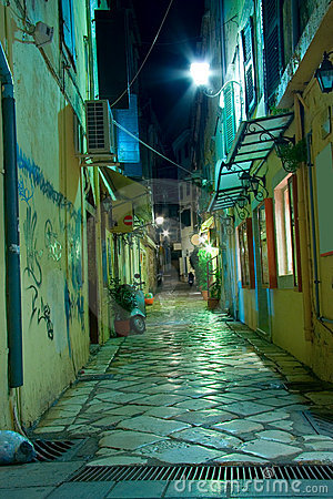 Narrow alley at night on Corfu island