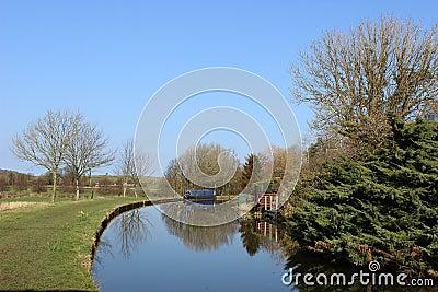 Narrow boat moored on Lancaster canal at Borwick