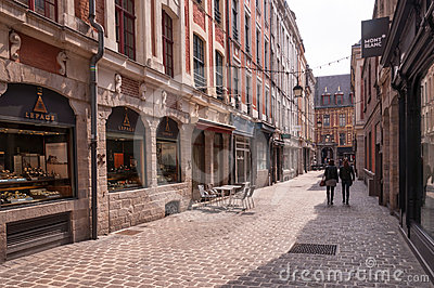 Narrow old cobblestone street in Lille, France Editorial Stock Photo