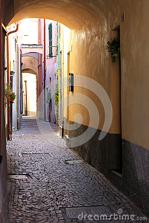 Narrow romantic alley in Noli, Italian Riviera