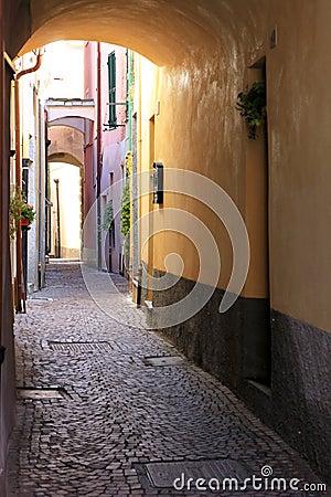 Narrow romantic alley in Noli, Italian Riviera