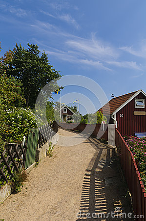 Free Narrow Street And Red Cottages In Sweden Stock Photos - 25927133