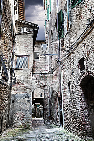 Narrow street between buildings (Siena. Tuscany, Italy)
