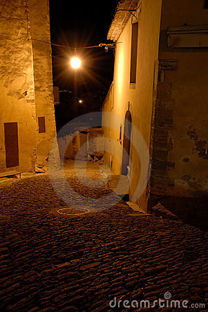 Narrow street in medieval town at night