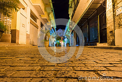 Narrow street at night in Old Havana