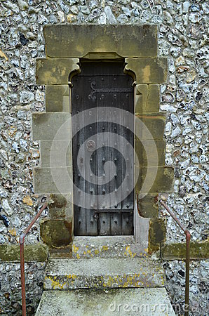 Narrow wooden door on English church.