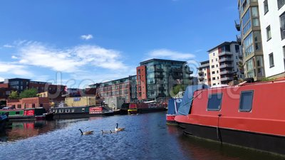 Narrowboats in the canals of Birmingham, United Kingdom. Birmingham, UK - May 23, 2019: Narrowboats in the canals of Birmingham, United Kingdom stock video footage