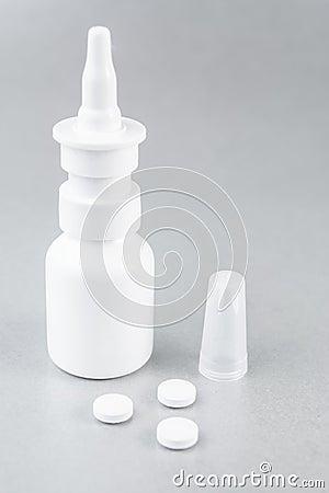 Nasal spray and white pills