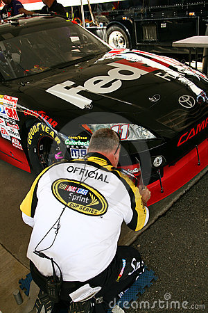 NASCAR - Official Inspects front splitter Editorial Stock Photo