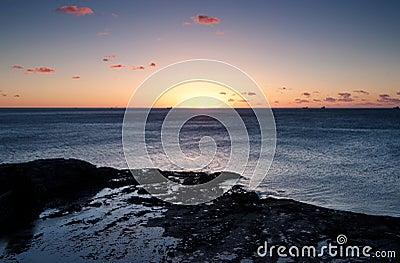 Nascer do sol do oceano em wollongong