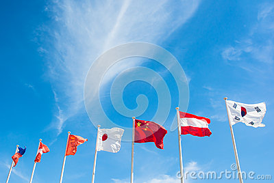 National of flag pole on blue sky