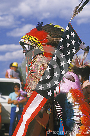 A Native American with an American flag Editorial Stock Photo