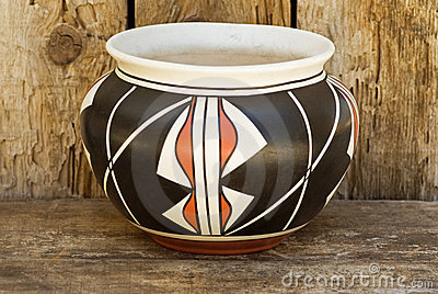 Native American Indian pottery on wood shelf