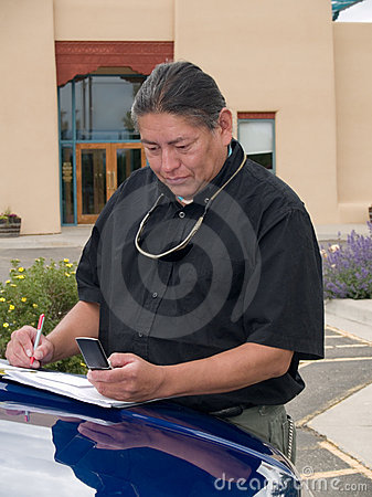 Native American man calling on cell phone