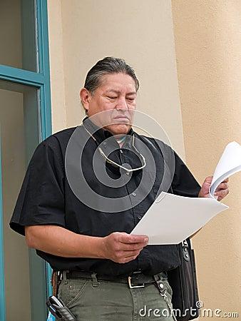 Native American man glancing at papers