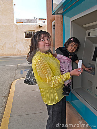 Native American woman at an ATM