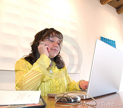 Native American woman on a cell phone in office